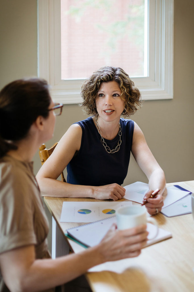 Jacki reviewing financial plan with client